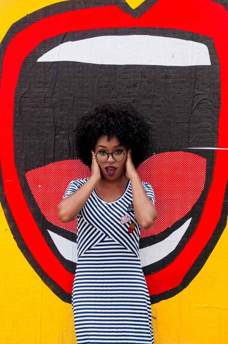 photo of woman wearing striped dress
